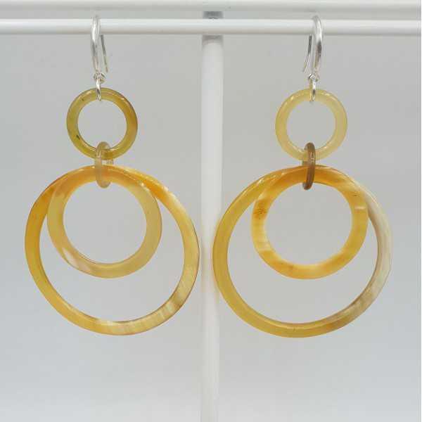 Earrings with rings of buffalo horn