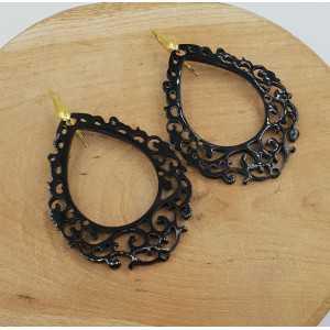 Earrings with an open worked drop of black buffalo horn