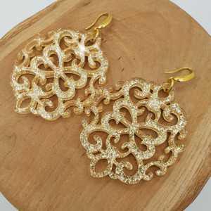 Goud vergulde oorbellen met grote gouden resin hanger