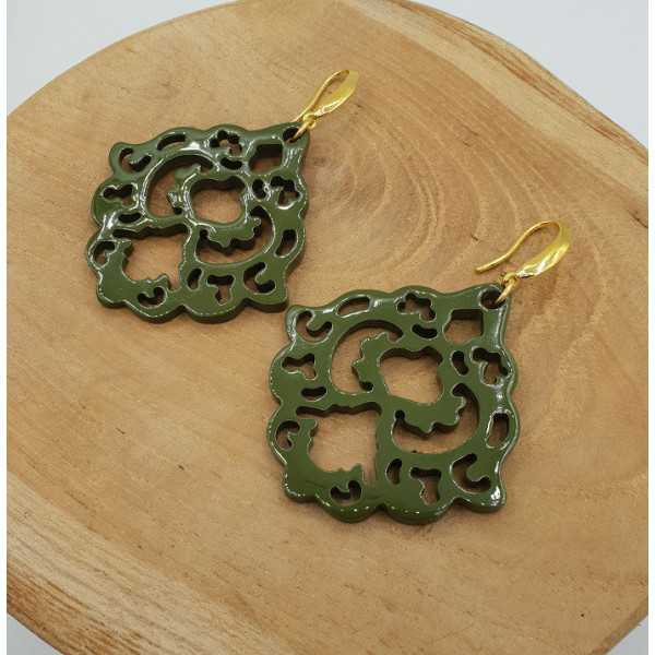 Earrings with green lacquered buffalo horn
