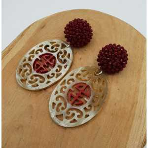 Silver earrings with buffalo horn and red crystals