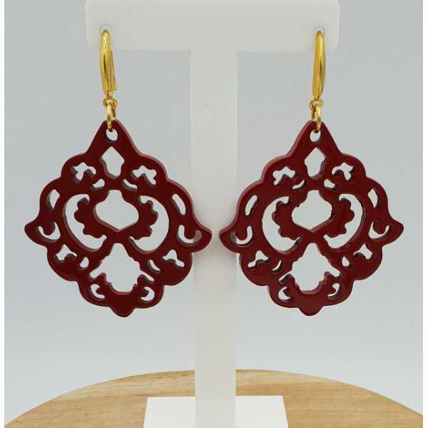 Earrings with red lacquered buffalo horn