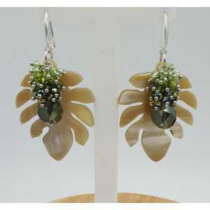 Silver earrings with leaf of buffalo horn and green crystals