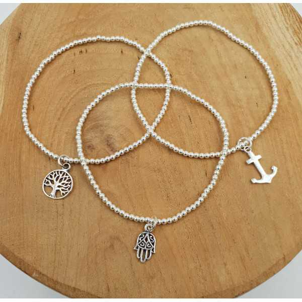 Silver bracelet with silver beads and charm