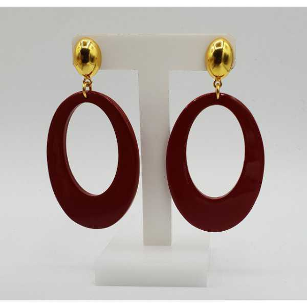Earrings with oval red buffalo horn pendant
