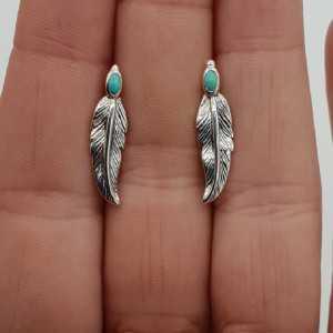 Zilveren oorbellen / oorklimmers met veer en Turkoois