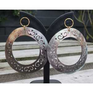 Gold plated earrings with large carved blacklip shell rings