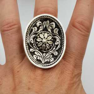 Silver ring with large oval machined head adjustable