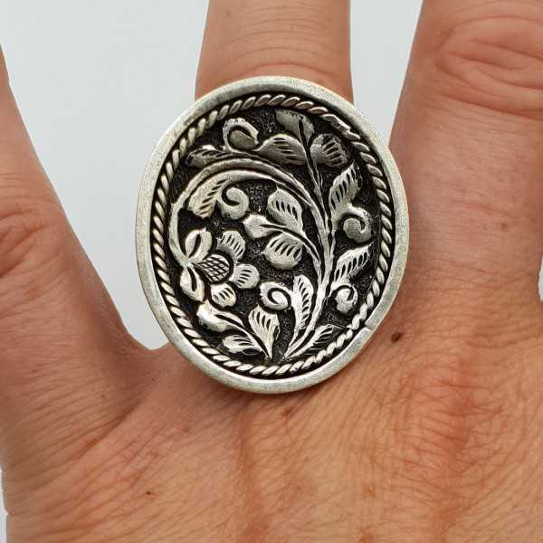 Silver ring with oval machined head adjustable
