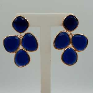 Rosé goud kleurige oorbellen met donker blauwe Kattenoog