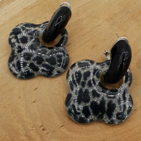 Black creoles with clover resin pendant with tiger print