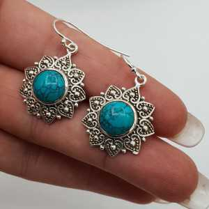 Silver earrings set with round cabochon Turquoise
