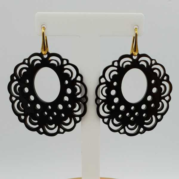 Earrings with carved black buffalo horn pendant