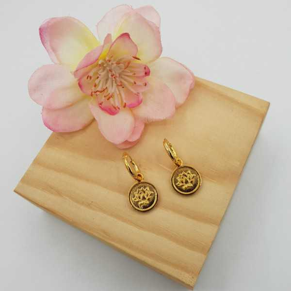 Gold-plated creoles with circular pendant with lotus