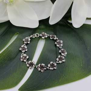 Zilveren bloemen armband