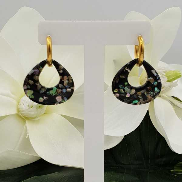 Creoles with a wide teardrop shaped pendant with pieces of shell
