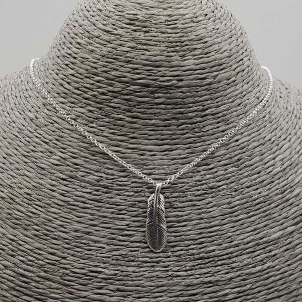 Silver necklace with feather pendant
