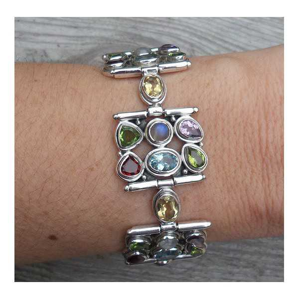 Silver bracelet set with facet cut multi gemstones