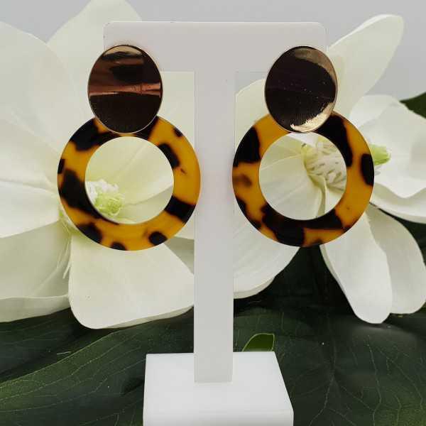 Goldfarbende Ohrringe mit Harz-Anhänger