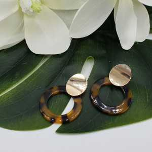 Gold colored earrings with resin pendant
