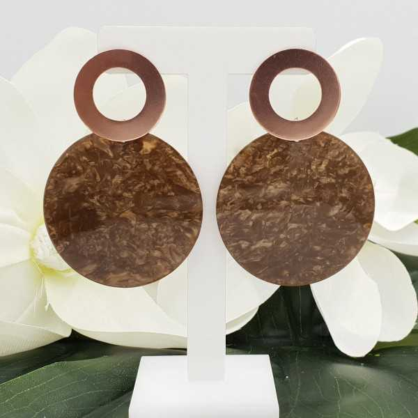 Rosé gold-plated earrings with round resin pendant