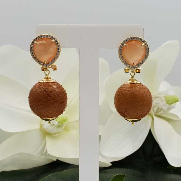 Gold earrings with orange cats eye and orb of Snakeskin