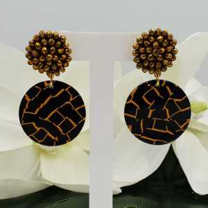 Gold plated earrings with golden crystal and resin pendant