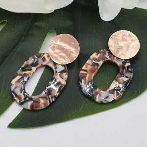 Earrings with beige brown black resin pendant