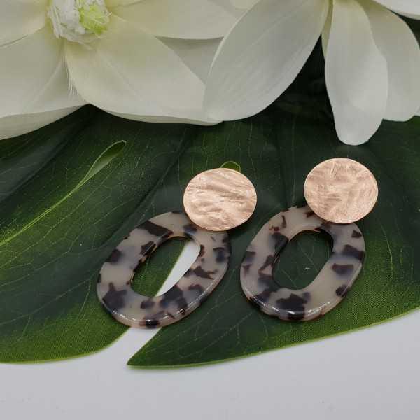 Earrings with tortoise resin pendant