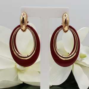Gold creoles with red buffalo horn pendant