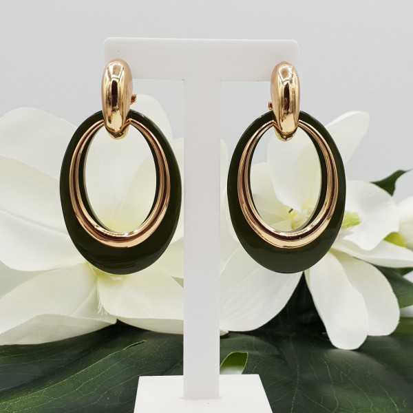 Gold creoles with green buffalo horn pendant