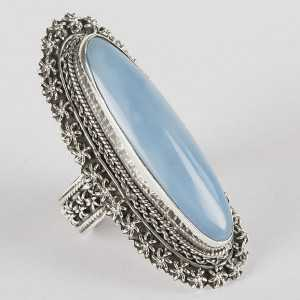 Zilveren ring gezet met grote ovale blauw Opaal 18.5 mm