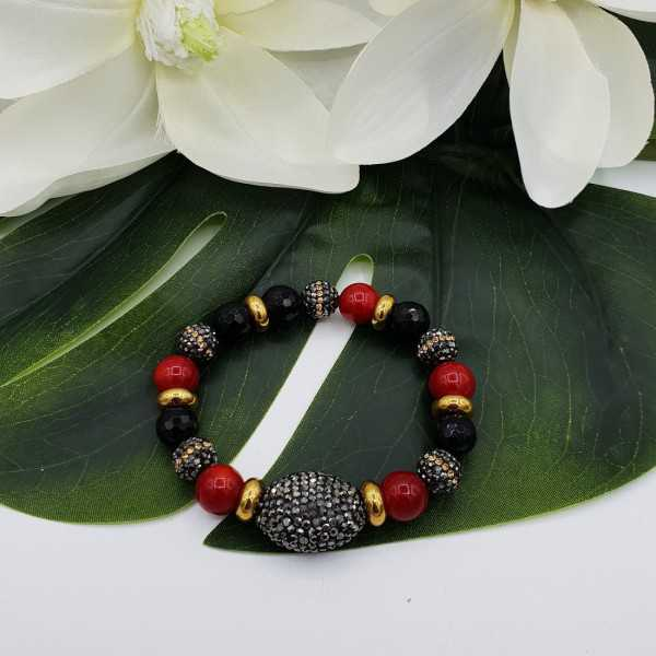 Bracelet of black Onyx Coral and crystals