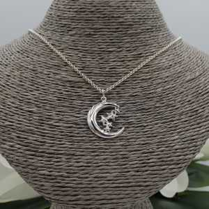 Silver necklace with moon and star pendant