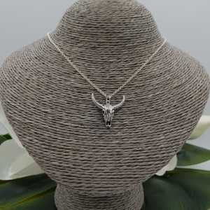 Silver necklace with skull pendant