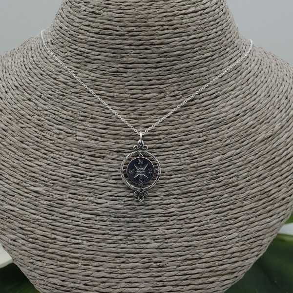Silver necklace with compass pendant