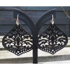 Silver earrings set with carved black buffalo horn