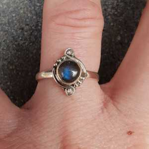 Silver ring with a small round Labradorite
