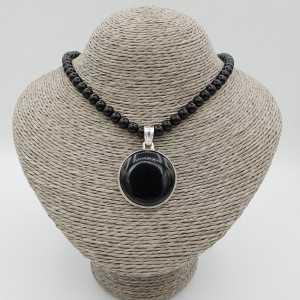Zilveren ketting met zwarte Onyx en ronde hanger gezet met zwarte Onyx