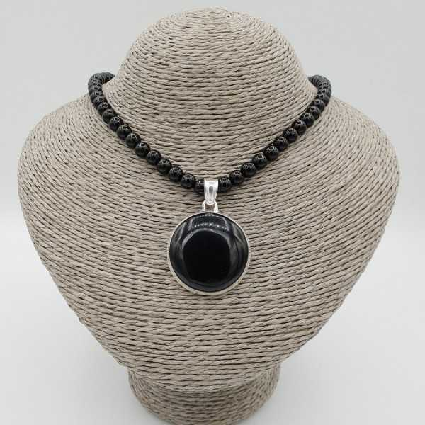 Silver necklace with black Onyx and round pendant set with black Onyx