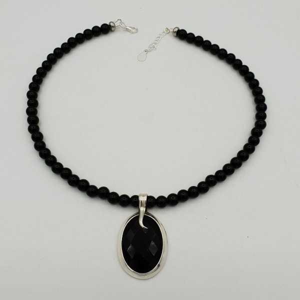 Zilveren ketting met zwarte Onyx en ovale hanger gezet met zwarte Onyx