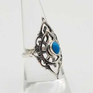 Zilveren ring gezet met Turkoois en bewerkte kop 17.3 mm