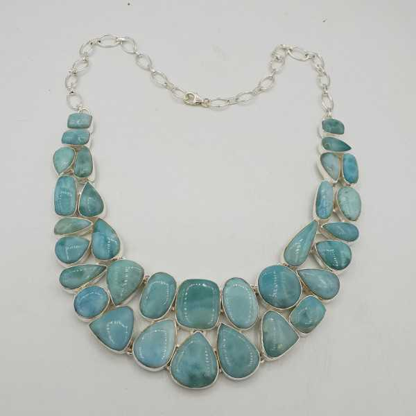 Silver necklace set with cabochon cut Larimar.