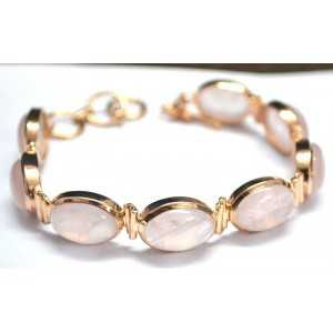 Gold plated bracelet set with cabochon rose quartz