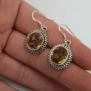 Silver gemstone earrings set with oval faceted Citrine