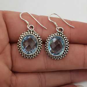 Silver gemstone earrings set with oval facet blue Topaz
