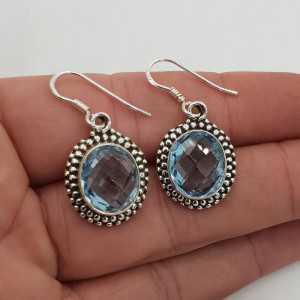 Zilveren edelsteen oorbellen gezet met ovale facet blauw Topaas