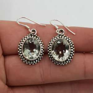 Silver gemstone earrings set with oval faceted green Amethyst
