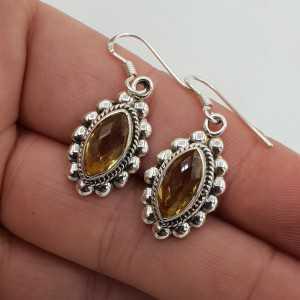 Zilveren oorbellen gezet met marquise facet geslepen Citrien
