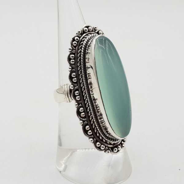 Silber ring mit aqua Chalcedon und geschnitztem Kopf